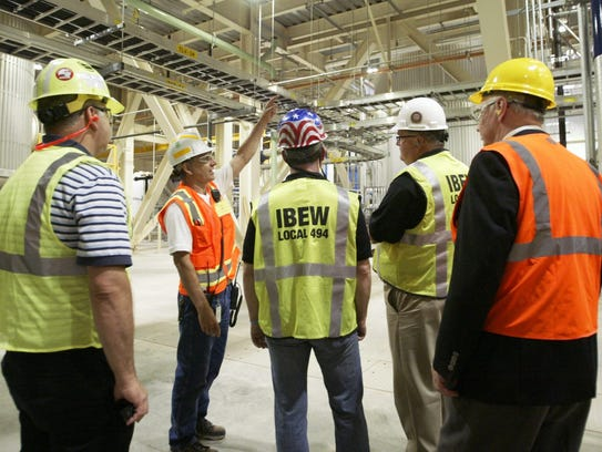 A plant manager gives a tour of the new baghouse and