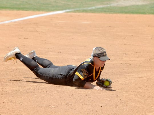 Third baseman SeaEnna Satcher dives to record an out during Newbury Park's 3-1 win over Riverside-ML King in the CIF-SS Division 2 championship game Saturday in Irvine.