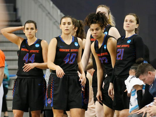 Boise State players, including from left to right, guard Brooke Pahukoa, guard Brittney Pahukoa, forward Joyce Harrell and guard Riley Lupfer, walk from the bench as time runs out in a first-round game against UCLA in the NCAA women's college basketball tournament, Saturday, March 18, 2017, in Los Angeles. (AP Photo/Danny Moloshok)