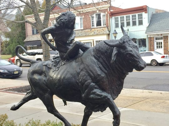 A young bullrider shows one way to travel down Kings