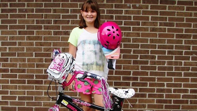 Emma DesJardins of Brown City won a bike during the DARE bicycle drawing at the Sanilac County 4-H Fair.