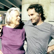 This image provided by the Curtis family shows Nancy Curtis, left, and her son, Peter Theo Curtis, right, in Boston, Tuesday. Curtis, a freelance reporter who wrote under the byline Theo Padnos and who had been held hostage for about two years in Syria, returned to the U.S. Tuesday.
