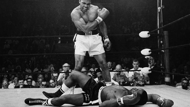 Muhammad Ali stands over fallen challenger Sonny Liston on May 25, 1965, in Lewiston, Maine.