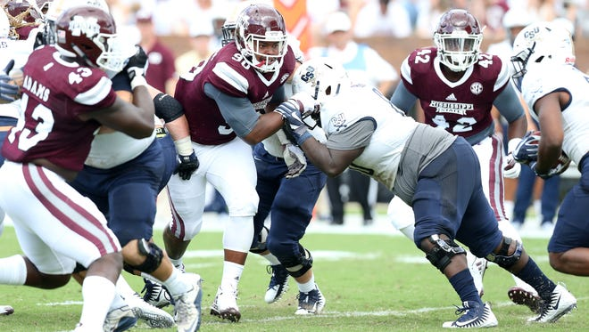 Mississippi State defensive lineman Grant Harris, center, earned more playing time as a junior but faces a fight to get significant playing time as a senior in 2018.