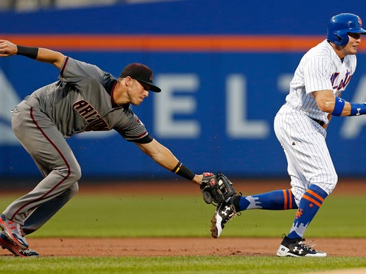 New York Mets Brandon Nimmo is tagged out by Arizona Diamondbacks third baseman Jake Lamb during the first inning of a baseball game on Monday, Aug. 21, 2017, in New York. (AP Photo/Adam Hunger)