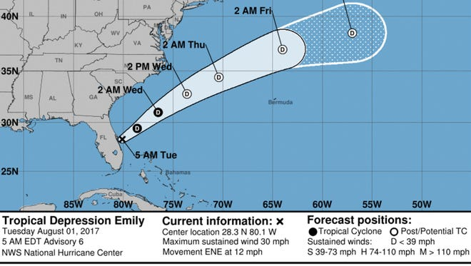 A graphic from the National Hurricane Center shows the position and forecast track of Tropical Depression Emily at 5 a..m. Tuesday