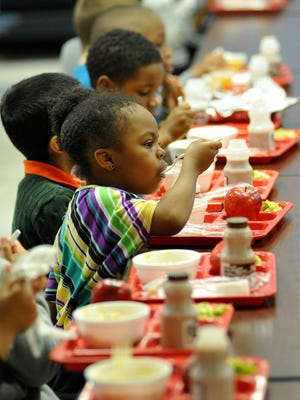 Childeren are shown eating lunch in this file photo.