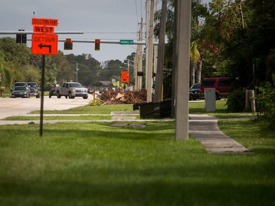 """There are no sidewalks for much of Southeast Floresta Drive south of Thornhill Drive, as seen Oct. 1, 2017, in Port St. Lucie. Steven Cook, who lives where the sidewalk ends, said, """"Our children go to the bus stop a couple blocks nearby. There's no sidewalks, there's no elevated barrier to keep traffic from hitting them."""""""