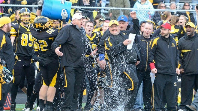 Keyser's 2012 football players celebrate their 51-22 win over Fort Hill with a bucket of ice over coach Sean Biser's head in this News Tribune file photo.