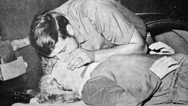 """As part of fire safety week, volunteer firefighter Gary Revier demonstrated mouth-to-mouth resuscitation on """"Rescue Annie"""", the Redwood Falls Fire Department's mannequin, as seen in this photo that first appeared in the Oct. 8, 1970 Redwood Gazette."""
