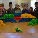 Isabella Kramb, left to right, Cyril Uebbing, Trudy Poux, Philip Stephens, Freddy Carroll, Yahya Lorick, Arlo Stone, Bailey Allen, Hannah Gendron, Eamon Lynch, Jane Uebbing, Zack Craft and Adele Fredericks are shown with their fractal project at Oakwood Friends School.