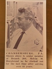 A 1965 retirement photo features Melvin M. Hargleroad. He was one of 49 post office employees who signed a document in 1938 that was hidden under the floor during renovations at the current Coyle Free Library which was the Chambersburg post office.