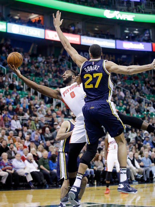 Detroit Pistons center Andre Drummond (0) plays the ball as Utah Jazz center Rudy Gobert (27) defends during the first quarter in an NBA basketball game, Monday, Jan. 25, 2016, in Salt Lake City. (AP Photo/Rick Bowmer)