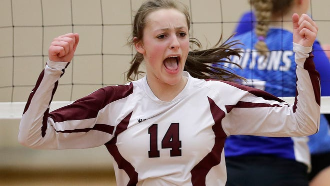 De Pere's Kate Koenig celebrates a point against Green Bay Notre Dame in a FRCC match on Sept. 22. The Redbirds play Hortonville in a WIAA Division 1 sectional semifinal match Thursday at Ashwaubenon.