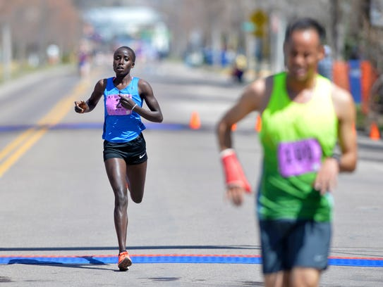 Vicoty Chepngeno of Kenya is the first female runner to cross the finish line with a time of 26:34 in the 5-mile run during the 39th Annual Ice Breaker Road Race Sunday.