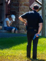 Lt. Jason Lawson of the Burlington Police Department, right, participates in a use of force training exercise with Tammy Boudah of the Howard Center's Street Outreach Team in Burlington on Tuesday, September 13, 2016.  Boudah is portraying a distraught woman armed with a knife as Lawson and his partner Officer Derek Hodges, not pictured, attempt to de-escalate the situation with a peaceful resolution.