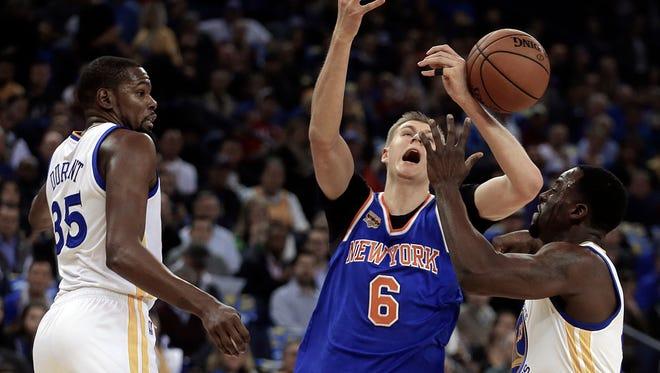 The Knicks' Kristaps Porzingis loses the ball against the Golden State WarriorsThursday, Dec. 15, 2016, in Oakland, Calif.