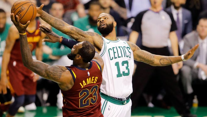 May 13, 2018; Boston, MA, USA; Boston Celtics forward Marcus Morris (13) defends Cleveland Cavaliers forward LeBron James (23) during the third quarter in game one of the Eastern conference finals of the 2018 NBA Playoffs at TD Garden.