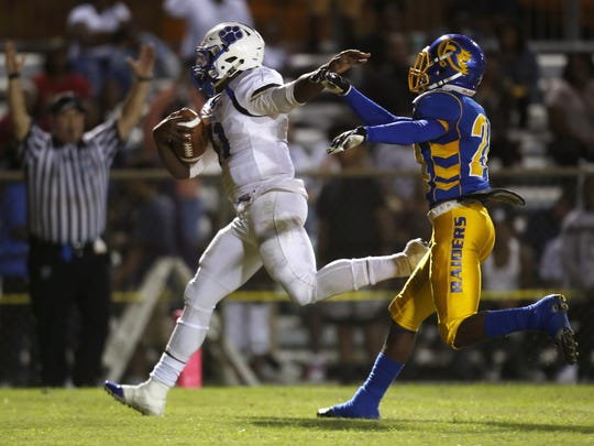 Godby quarterback Darius Bradwell runs into the endzone for a touchdown past Rickards' Tavyn Jackson during their game at Cox Stadium on Friday.