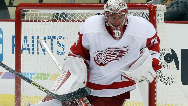 Detroit Red Wings goalie Jared Coreau (31) makes a save against the Pittsburgh Penguins during the third period at the PPG Paints Arena. The Red Wings won 5-2.