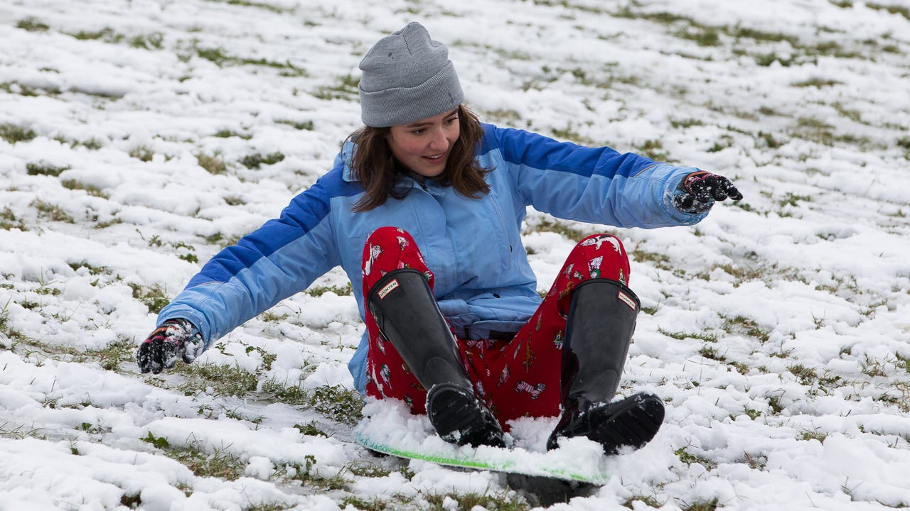 Corpus Christi residents play in snow at Cole Park