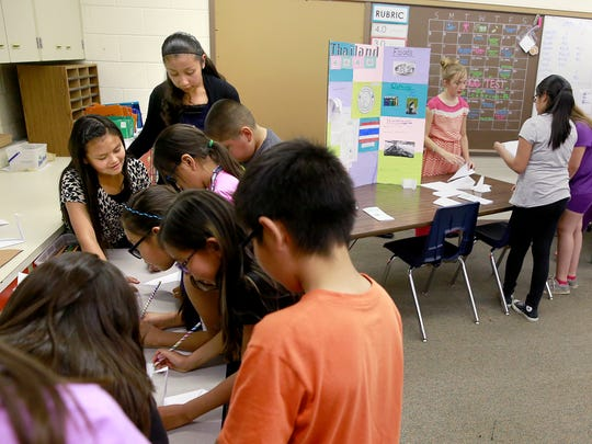 Fifth-graders Mia Toledo, left, and Gabriella Velazquez lead other students in an activity aimed at helping them learn about Egypt during Multicultural Day on Thursday at Apache Elementary School.