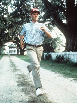 """Tom Hanks in a scene from the 1994 film """"Forrest Gump,"""" goes for a run in his fictional hometown of Greenbow, Alabama."""
