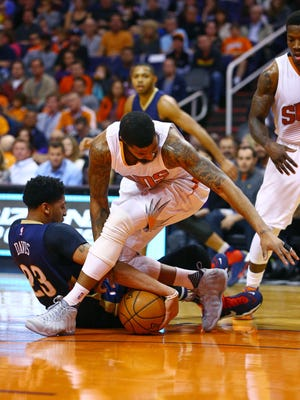 Nov 25, 2015: New Orleans Pelicans forward Anthony Davis (left) grabs a loose ball against Phoenix Suns forward Markieff Morris in the first quarter at Talking Stick Resort Arena.