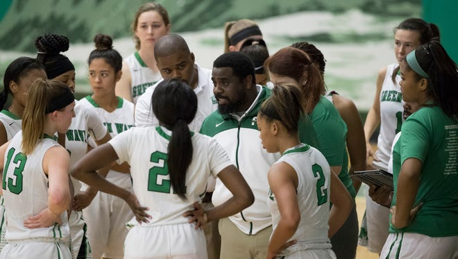 Fort Myers girls basketball coach Chad Terrell talks to his team during a state playoff game last season.