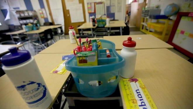 Desks and supplies inside a classroom.