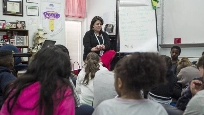 Diana Pearson talks to her class about their stories before they go to work during class. Pearson teaches the fifth grade at Lakeview Elementary School and will visit her students on the weekend during her days off.