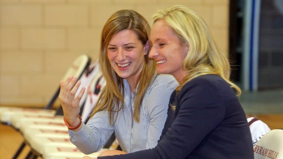 Byram Hills girls basketball coach Alyse La Padula, left, and assistant coach Albana Krasniqi laugh with each other before a game against White Plains at Byram Hills High School in Armonk Dec. 11, 2015. La Padula played for Krasniqi in basketball and softball at Purchase College.