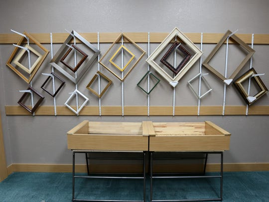 "The newly renovated Elsinore Framing & Fine Art Gallery includes a Frame it Fast area with ""readymade"" frames and mattes in standard sizes. The matte tables in this photo were constructed from old print bins."