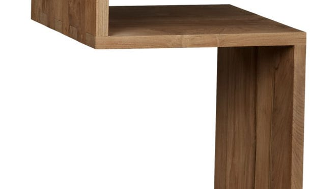 Take a peek at teak. Entu side table, $349 at Crate & Barrel.