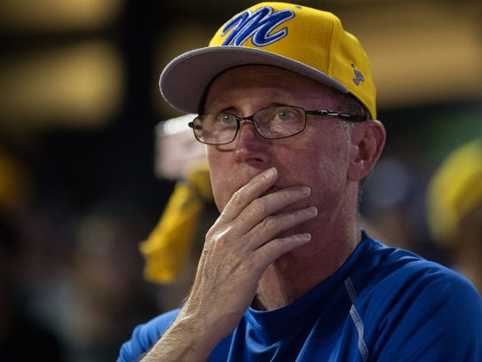 A Moody fan watches during the seventh inning of their
