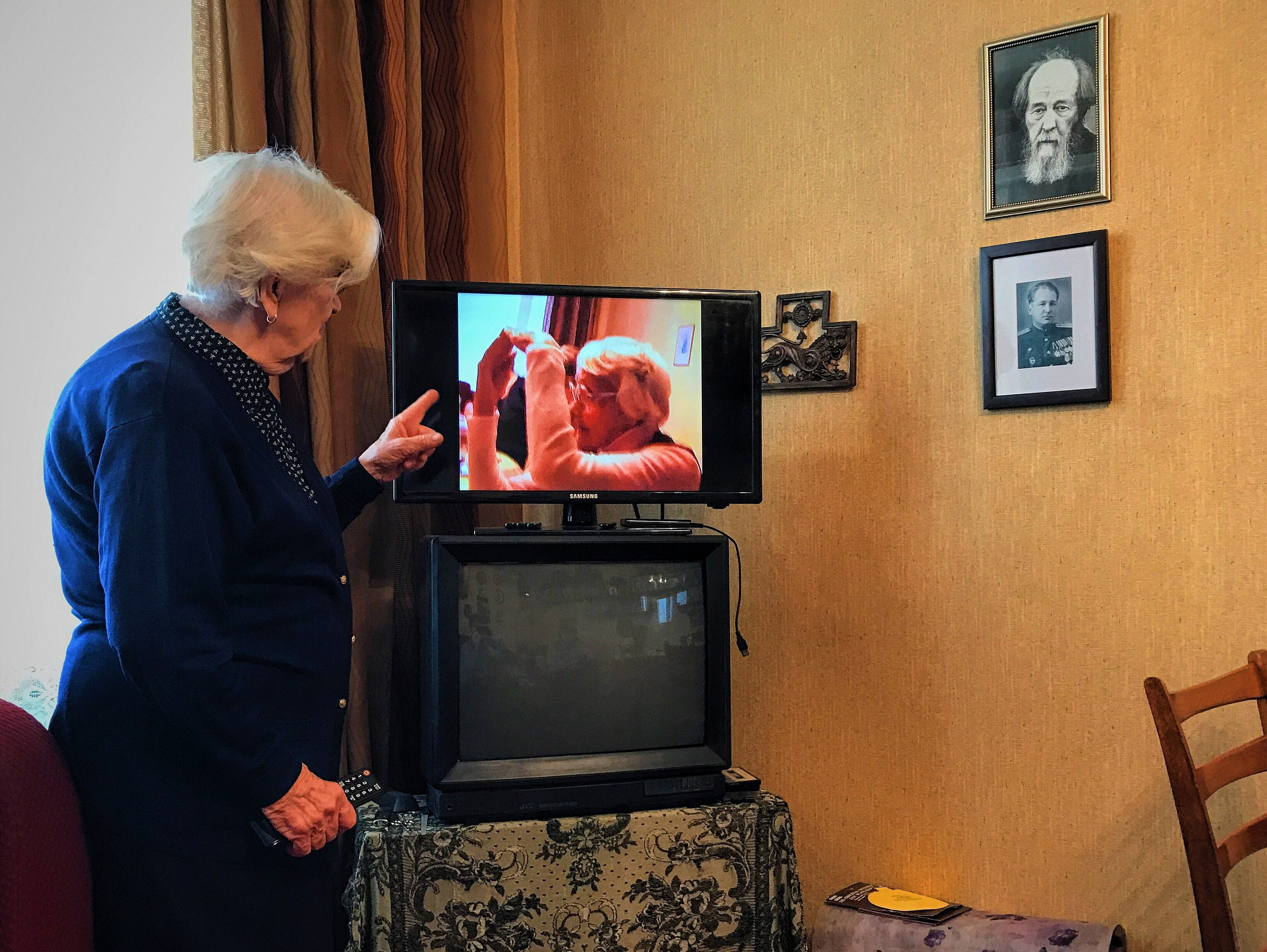 Lyudmila Alekseevna Khachatryan shows a video in her