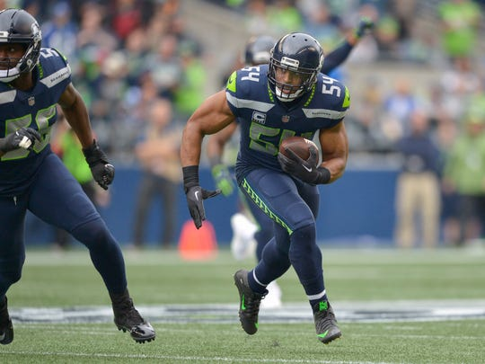 Linebacker Bobby Wagner returns an interception during the first half of the Seahawks' 12-9 win over the 49ers on Sunday.