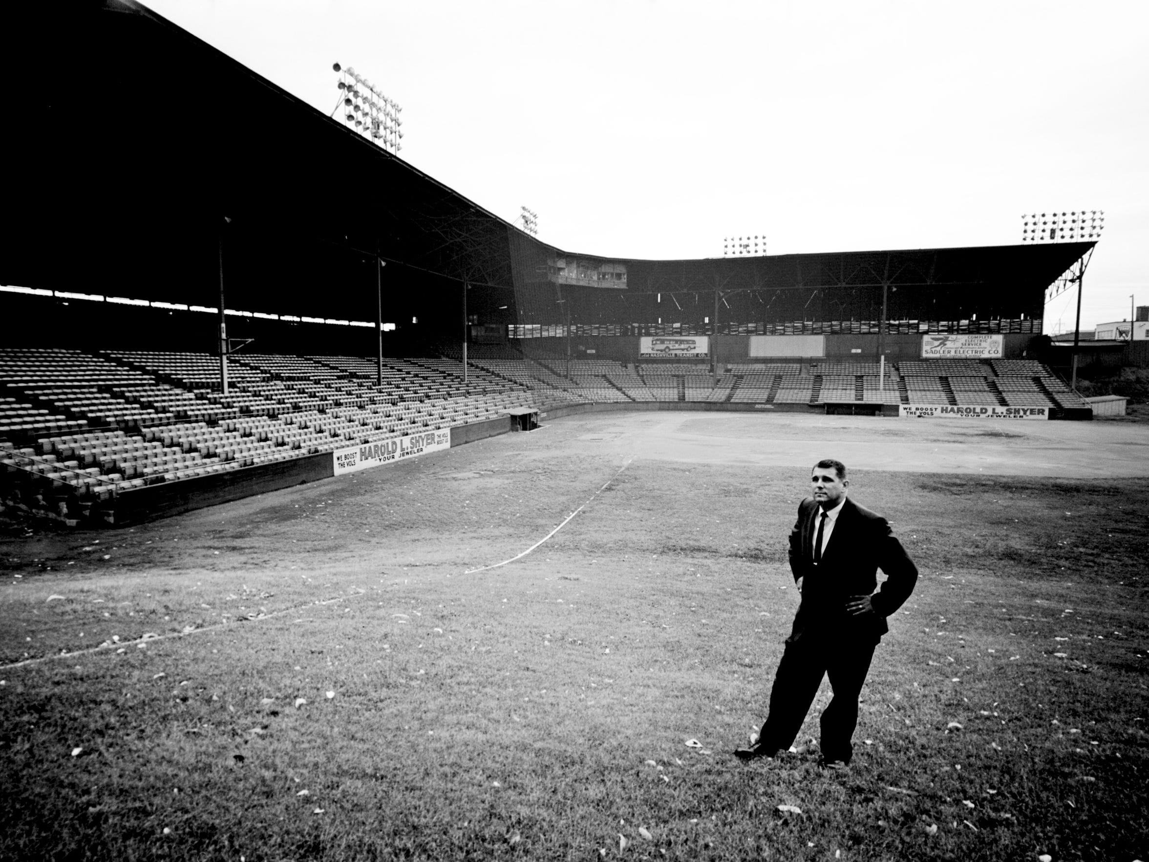 Nashville Vols General Manager Bill Harbour takes a long look at the famous right field screen of Sulphur Dell after learning Jan. 26, 1962 that baseball is dead in Nashville for the 1962 season. This will be the Dell's first year of idleness since 1901, the year that the Southern League was organized.