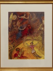 "A framed print from Marc Chagall's ""Le Cirque"" exhibit"