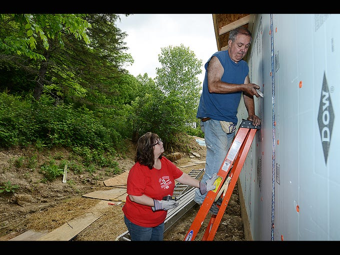 Mike and Tammy Smith work on their home as part of