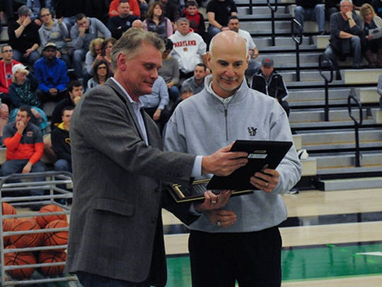 Chuck Abbott, right, is seen here after being honored by Gordie Kauffman, a board member of the Gretchen Wolf Swartz Scholarship Program. Abbott will soon receive the 2019 Distinguished Service Award from the Pennsylvania State Athletic Directors Association.