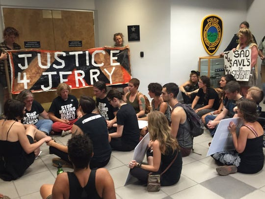 "Several protestors sat at the Asheville Police Department on July 21. They demanded justice for Jai ""Jerry"" Williams, 35, who was shot by a police officer July 2 after police say he displayed a weapon."