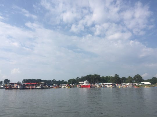 Boats line Assateague Channel in anticipation of 2016 Chincoteague Pony Swim on Wednesday, July 27, 2016.
