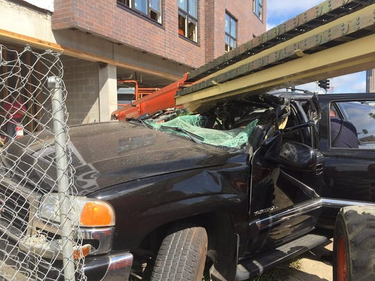 An SUV crashed into a construction site lift at Southwest 9th Street in Des Moines after a police chase on Thursday, July 28, 2016.
