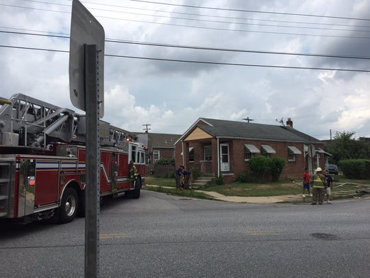 Three people were displaced because of a kitchen fire