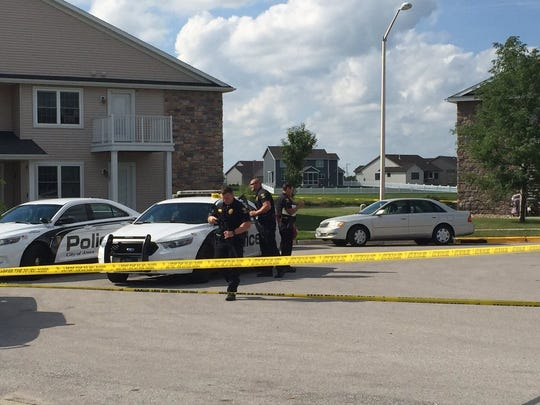 Police investigate a shooting scene in 3800 block of Tiverton Court, Ames, on Tuesday, Aug. 9, 2016.