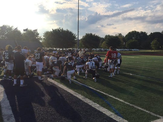 New LVC head football coach Joe Buehler addresses his team following practice on Wednesday afternoon.