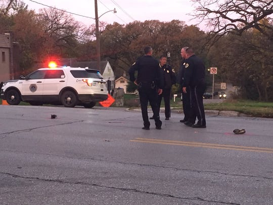 Des Moines police investigate an intersection where a 12-year-old boy was fatally hit by a car crossing Southwest Ninth Street on Oct. 27, 2016.