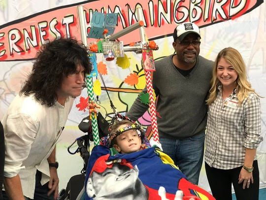 Tommy Thayer and Darius Rucker at the launch of the