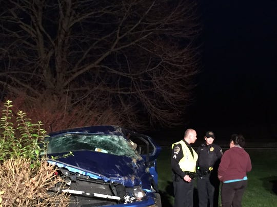 First responders attend to the scene of a crash in Heidelberg Township Sunday night.